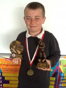"Kalvin with his ""players' player of the year"" award and ""Top Scorer"" award from Mallow United Soccer Club"