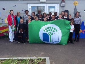 Mrs O'Riordan, Principal, Green School's Committee and Green School Co-ordinator Ms. Coghlan, accept the Green Flag from Caroline, our Green School's Representative.