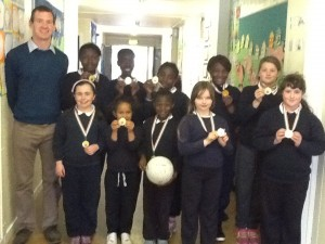 Mr. Buckley with the girls junior and senior football teams from the Blitz.